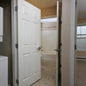 Laundry Closet, Upper Bath & Bedroom Three